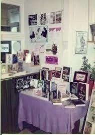 Photo: Interior of Lavender Menace showing purple covered display table and posters